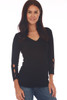 Front shows black top with 3/4 sleeve length & a wonderful rib-knit material, v-neckline with cut-outs at bottom arm. Shown worn with blue jeans.