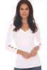Front shows white top with 3/4 sleeve length & a wonderful rib-knit material, v-neckline with cut-outs at bottom arm.