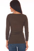 Back shows brown top with 3/4 sleeve length & a wonderful rib-knit material, v-neckline with cut-outs at bottom arm. Shown worn with blue jeans.