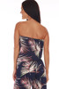 Back shows navy blue tube top jumpsuit with all over palm tree design, an elastic band at top, drop-waist line, and stretchy material.