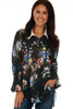 front shows  long sleeve black blouse featuring a velvet color, button up front, white collars, super wide bell sleeves & all over colorful flower appliques.