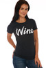 """Front shows black short sleeve tee with the word """"wino"""" at front. Shown warn with blue jeans."""