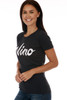 """side shows black short sleeve tee with the word """"wino"""" at front. Shown warn with blue jeans."""