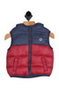 Front shows dark blue and red puffer vest featuring a zip-up front with front pockets, reversible inside & super soft and thick puffer material!