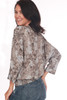 back shows brown and grey patterned blouse featuring 3/4 length sleeves, dolman fit and elastic band at bottom. Worn with blue jeans.