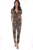 This cheetah print jumpsuit by Veronica M. features a surplice cross front with short sleeves, waist tie & cinched waist band and tapered skinny legs. True To Size. Shoulder To Hem Measurement: Approximately 52 in. 100% Polyester.  Machine Wash Cold, Tumble Dry Low.