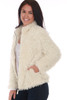 Side view shows pockets of the white faux fur jacket