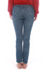 Rear view shows blue denim Levi's 501 fitted skinny jeans