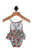 Back view of Floral Ruffle Printed Swimsuit for Infants has pink, red and white flowers with green leave.  Back has criss-crossed straps and ruffles on the bottom.  85% Polyester, 15% Elastane. Machine Wash Cold Inside Out, Tumble Dry Low.