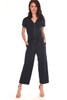 Feona Pebble knit short sleeved Jumpsuit in navy has a v-neck with front zipper and fabric tie belt. Shoulder To Hem Measurement is approximately 51.0 in.  50% Cotton, 50% Modal.  Machine Wash Cold, Hang to Dry.