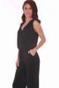 The side view of this super simple Veronica M. black  jumpsuit features a v-neck surplice front with no sleeves, cinched waist and wider pant legs and side slit pockets. True To Size. Shoulder To Hem Measurement is Approximately 59 inches. Shell - 94% Polyester, 6% Spandex.  Machine Wash Cold, Tumble Dry Low