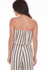 The back view shows bare shoulders of this strapless jumpsuit by Veronica M. features vertical black and gold stripes on white with a cinched waist & tie and culotte length. True To Size. Shoulder To Hem Measurement is Approximately 41 inches. 100% Polyester.  Machine Wash Cold, Tumble Dry Low