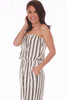 The side view of this strapless jumpsuit by Veronica M. features vertical black and gold stripes on white with a cinched waist & tie and culotte length. Also has side slit pockets. True To Size. Shoulder To Hem Measurement is Approximately 41 inches. 100% Polyester.  Machine Wash Cold, Tumble Dry Low