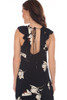Back view of this long sleeveless dress which is black with a white flower pattern shows the cut out back with tie at neck.  Ruffle at shoulder.  Side Zipper Opening.  Shoulder To Hem Measurement is approximately 53 inches at longest point.  100% Rayon.  Machine Wash Cold, Hang Dry.