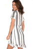 Tie Front short sleeve Striped Ruffle Mini Dress has a front tie closure and high low hem in navy and ivory.  FitsTrue To Size and has a lined skirt. The Shoulder To Hem Measurement is Approximately 35.5 in.  Fabric Content is 83.5% Rayon, 16.5% Cotton.  Machine Wash Cold, Line Dry.