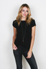 front shows black worn-in tee featuring a rounded neckline and knotted detailing on the cuffs. This easy tee has unfinished trim throughout. Shown worn with  black pants.