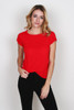 front shows bright red worn-in tee featuring a rounded neckline and knotted detailing on the cuffs. This easy tee has unfinished trim throughout. Shown worn with  black pants.