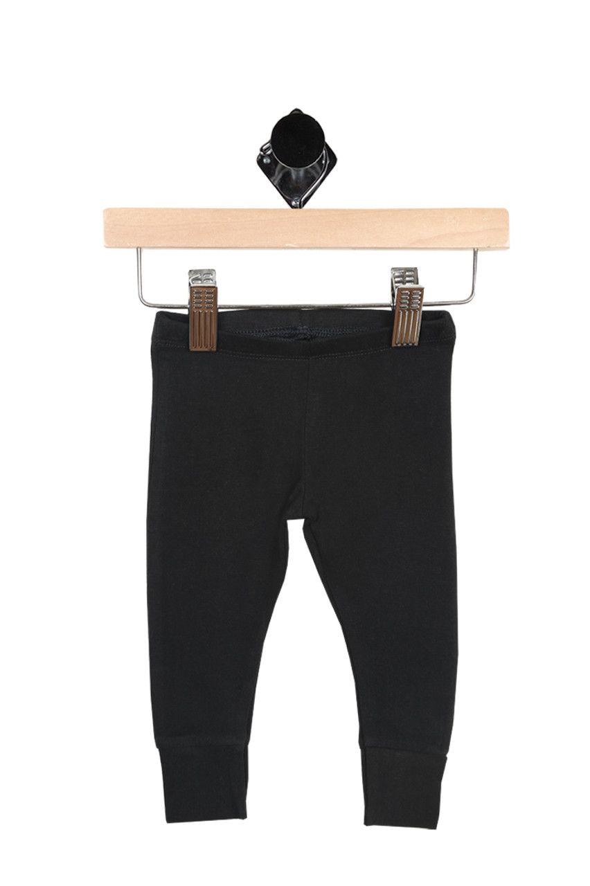 2474612bd81a8 Front shows leggings have elastic waist band with cuffed bottom hemline.  leggings are all black