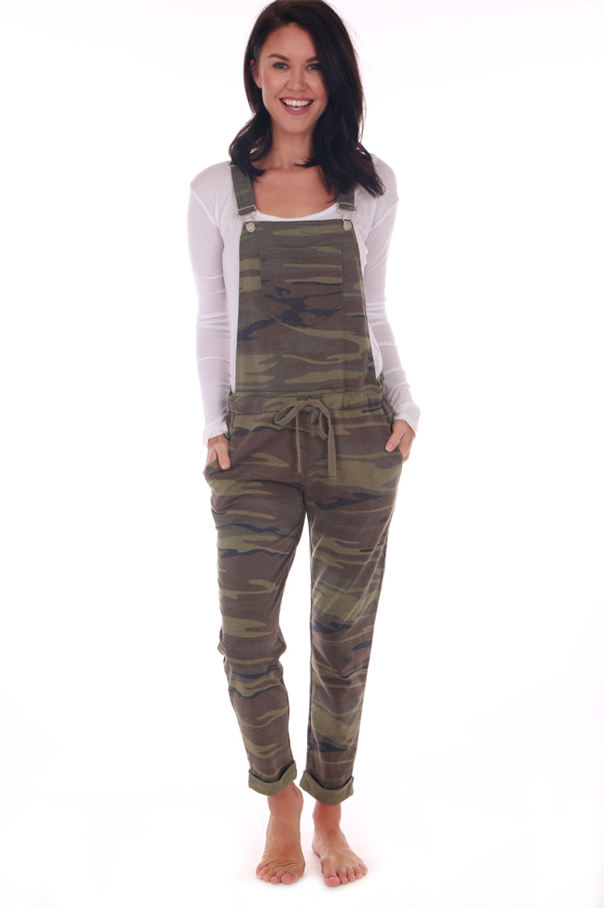 8cdf64ec94f Front shows camouflage overalls featuring the softest jersey material with  adjustable overall straps