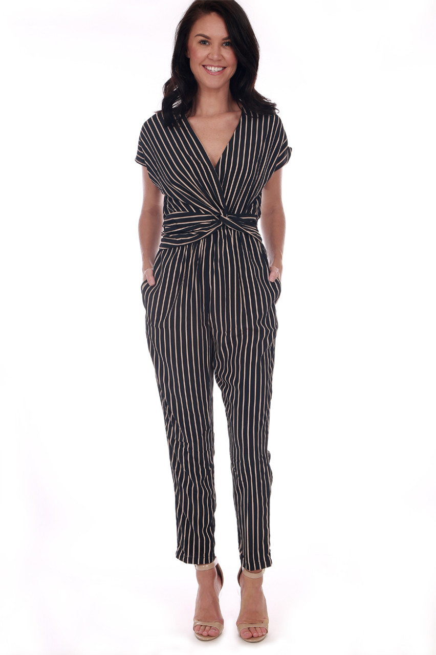 eccb1c1ff4cc front shows black striped short sleeve jumpsuit featuring a twist front  with deep v-neck