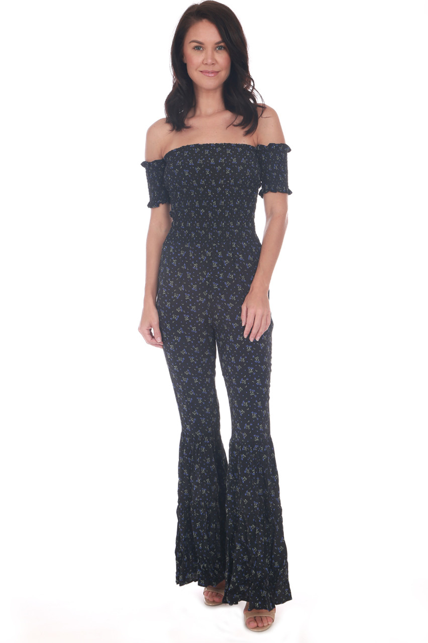 1c26284fb7e Black floral jumpsuit has a smocked off the shoulder top with smocked short  sleeves