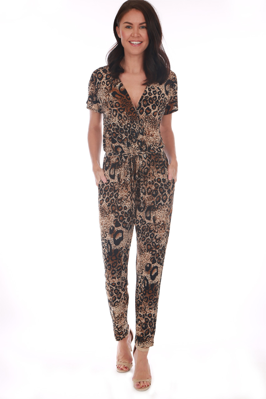 8334549fd56 This cheetah print jumpsuit by Veronica M. features a surplice cross front  with short sleeves