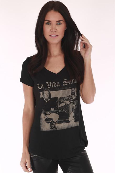 """Front shows soft black short sleeve shirt with slight v shape neckline print image and """"La Vida Santos"""" at front."""