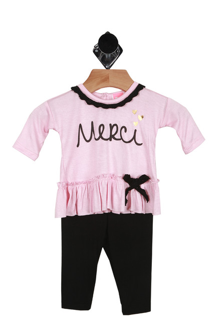 "Front shows two piece set. Long sleeve pink top with the word ""Merci"" and a black bow tie on bottom and black leggings."