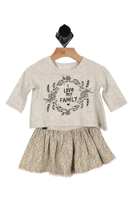 "Front shows two piece set. Mid length sleeved top with flower design and the words ""I Love My Family"" and flowered patterned skirt."