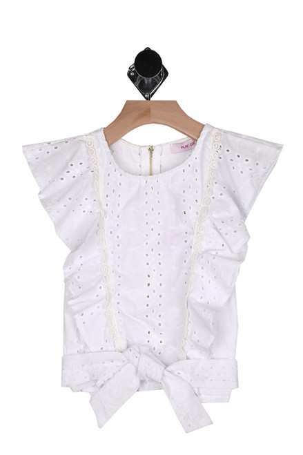 front shows eyelit white material with ruffle sleeves & ruffle detailing along front with front bottom tie