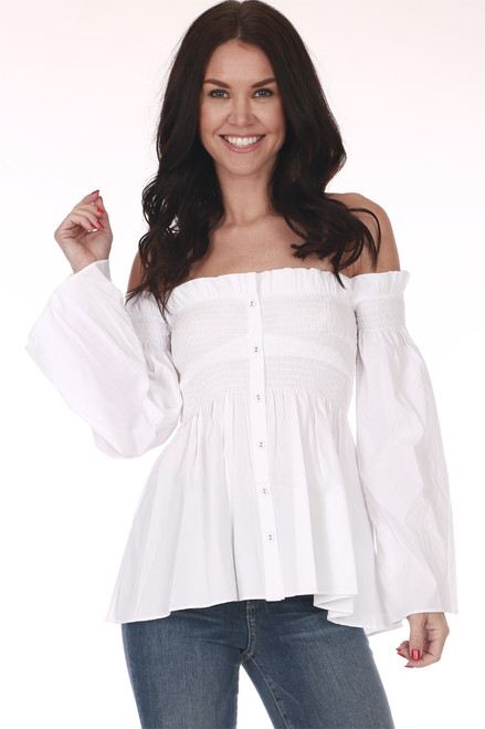 Front shows off shoulder white button up blouse with long wide flared sleeves and smock top.