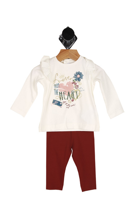 "Front shows two piece set featuring a long steep sleeve top with ruffle detailing at shoulders, ""From the heart"" printed at front in glitter with flower & heart drawings and matching burgundy leggings."