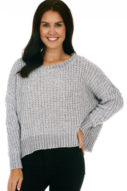 Side shows grey colored long sleeve sweater featuring a super soft chenille material with scoop neckline and slightly cropped bottom hemline.