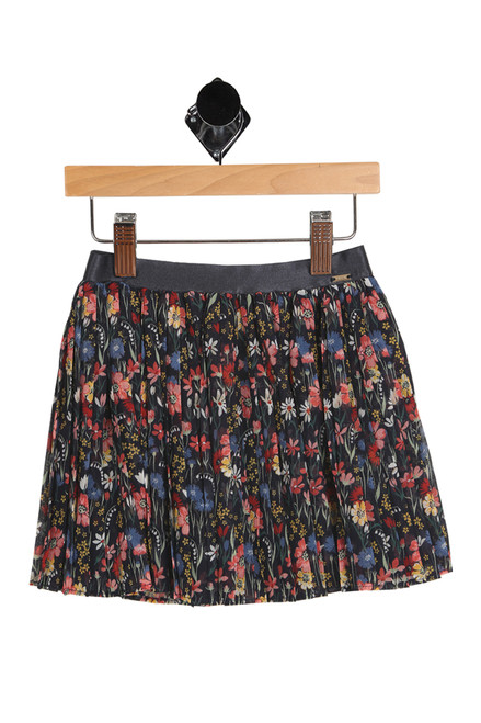 front shows skirt featuring an all over floral print with pleated material, elastic band at waist and fully lined underskirt.
