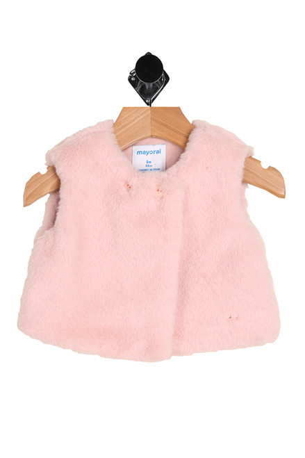 Front show super soft light pink faux fur vest featuring a two-button closure at front, long front hemline & fully lined inside.