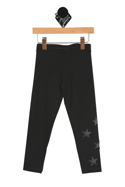 front shows black long leggings featuring an elastic band at top waist with pleather black stars at bottom left leg and the softest material.