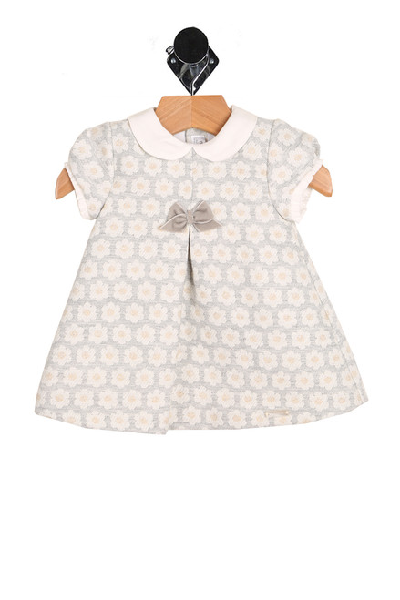 Front shows light grey and white dress featuring a super soft jacquard material with all over white and yellow flowers, collar, velvet bow at front, and fully lined underneath.
