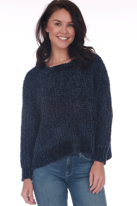 front shows deep blue chenille sweater featuring a slightly cropped hemline with longer sides, a wider fit, long sleeves & the softest chenille material.