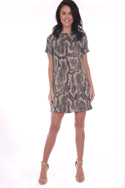 front shows short sleeve mini dress featuring an all over python snake print with back silver zipper, super short hemline and Fully lined.