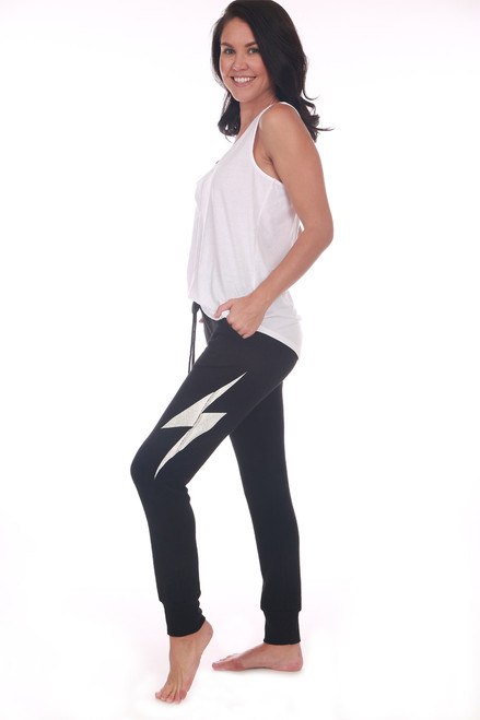 Black soft jogger pants with an elastic waistband with drawstring and elastic cuffed bottom. Has a white lightning bolt printed on left side of leg.