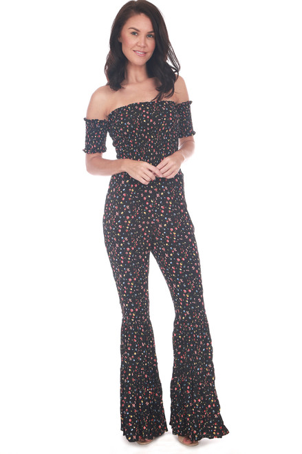 Jumpsuit has flared bottoms and a fitted look with an all over floral print.  Smocked off the shoulder top and smocked short sleeves.