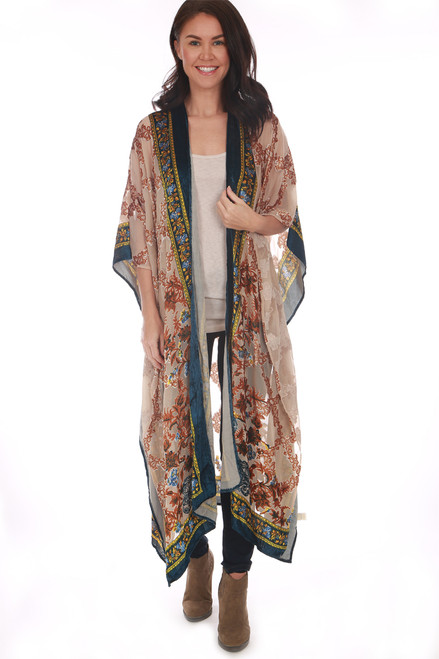 This kimono by Aratta features a semi-sheer material with velvet detailing, long & flowy fit and the prettiest blue, yellow & burnt orange print. One Size fits all. Shoulder To Hem Measurement: Approximately 49 in.