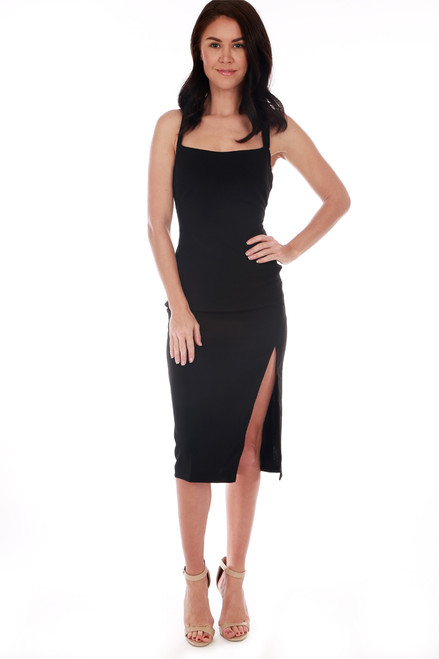 ASTR The Label dress features a straight-across neckline with strappy back and super high slit. Fitted. Shoulder To Hem Measurement: Approximately 43.5 in. 95% Polyester, 5% Elastane. Dry Clean Only.
