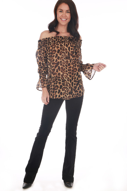 Off the shoulder blouse by Veronica M. features an all over cheetah print with smocked top, slightly see-through material and smocked wrists with flare sleeves. True To Size. Shoulder To Hem Measurement: Approximately 23 in.  100% Polyester. Machine Wash Cold, Tumble Dry Low.