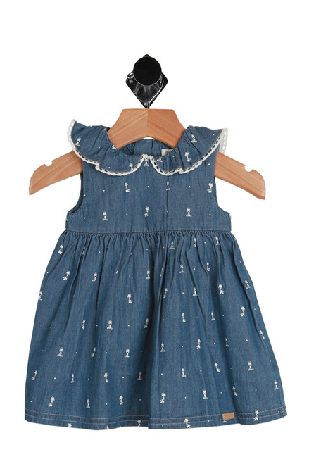 Chambray Giraffe Print Dress for Infants.  This little dress by Mayoral features a chambray denim-like material with ruffling at neckline, all over mini  giraffe print and hidden back zipper. In chambray blue with white giraffe print.  100% Cotton.  Machine Wash Cold Inside Out, Tumble Dry Low.