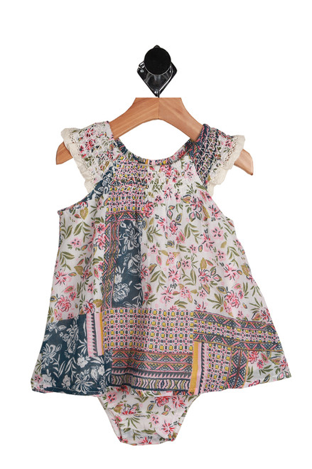 Floral Dress & Bloomers Set for Infants has pink flowers on a white background with blue details.  Sleeveless dress features elastic top with wider fitting dress and matching bloomers with elastic waist & leg holes. Set is 100% Cotton, Lining is 100% Cotton.  Hand Wash Cold, Air Dry.