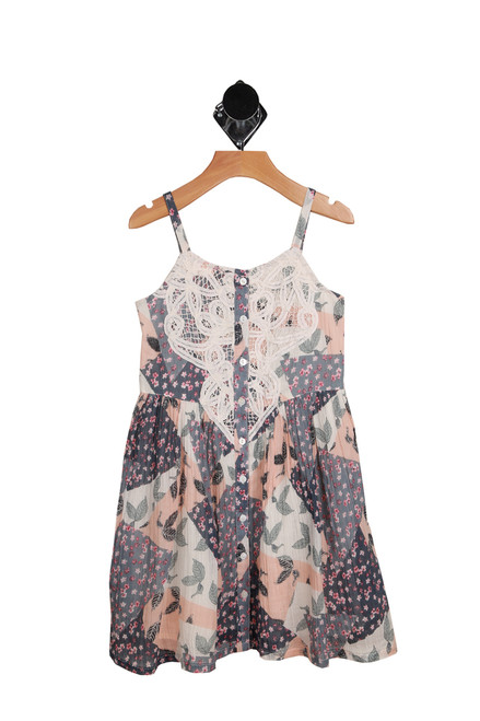 Isla Tea Dress for Little Kids. This dress features a lace front with buttons and adjustable spaghetti straps, smocked backing and fully lined. In grey and pink with pink small flowers.  Romper is 100% Cotton, Lining is 100% Cotton. Hand Wash Cold, Hang Dry.