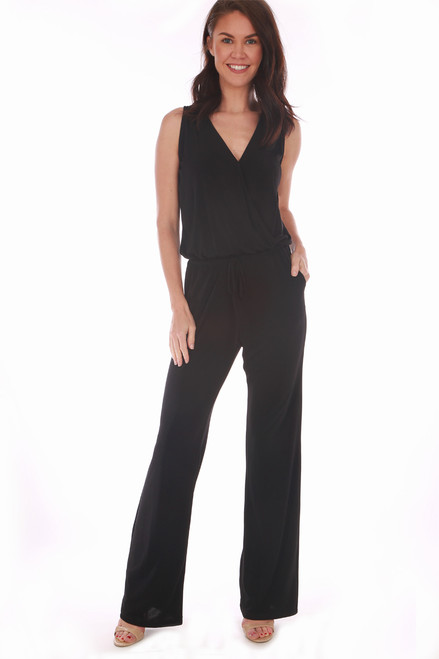 This super simple Veronica M. black  jumpsuit features a v-neck surplice front with no sleeves, cinched waist and wider pant legs.  True To Size. Shoulder To Hem Measurement is Approximately 59 inches. Shell - 94% Polyester, 6% Spandex.  Machine Wash Cold, Tumble Dry Low