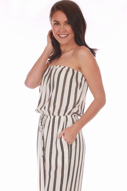 b7a9acfaf5f7 ... stripes on white with  The side view of this strapless jumpsuit by  Veronica M. features vertical black and gold ...