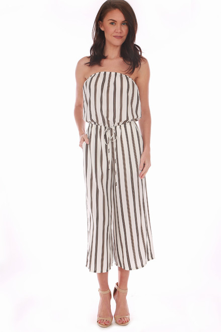 This strapless jumpsuit by Veronica M. features vertical black and gold stripes on white with a cinched waist & tie and culotte length. True To Size. Shoulder To Hem Measurement is Approximately 41 inches. 100% Polyester.  Machine Wash Cold, Tumble Dry Low